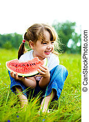 girl eating water-melon - cute little girl eating...