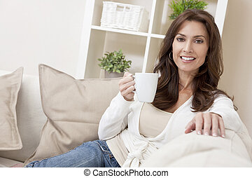 Woman Drinking Tea or Coffee at Home