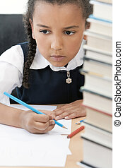 African American School Girl Writing In Class