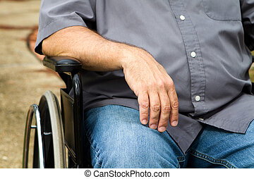 Disabled Man In Wheelchair - Close up of disabled man's arm...
