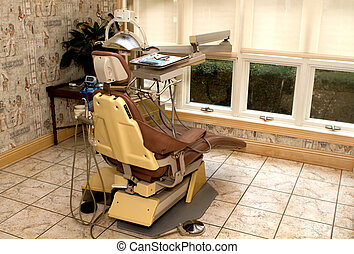 Dental Hygienist Chair - Dental hygienist chair in a dentist...
