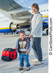 cute boy and his grandmother prepared to fly - Smile...