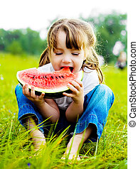 girl eating watermelon - cute little girl eating watermelon...