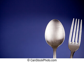 Silverware - photo of a fork and a spoon in front of a...