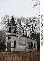 Old rustic country church side view - beautiful, old white...