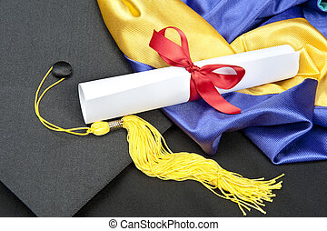 Graduation cap and diploma - A graduation setting with...