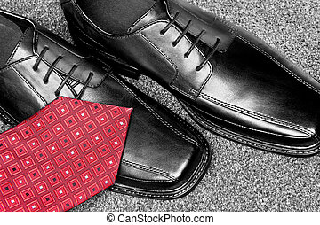 Black leather dress shoes and necktie - A red necktie on a...