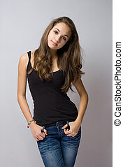 Beautiful relaxed young jeans model. - Portrait of a...