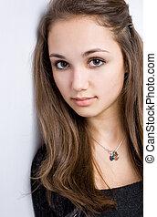 Closeup portrait of a brunette beauty.