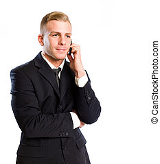 Busy on the phone. - Portrait of a handsome young businesman...