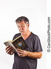 man reading in a book