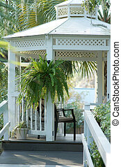Inviting Gazebo outside in a southern style garde.