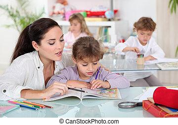 Teacher with a pupil