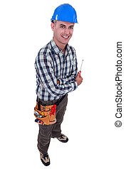 Smiling tradesman holding a screwdriver