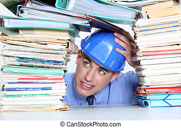 An architect worry about his folders construction.