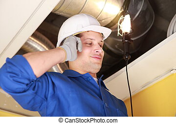 Plumber on mobile phone