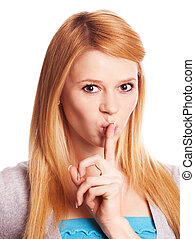 hush - beautiful young woman with her finger near her lips a...