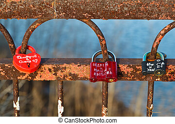 Love Locks on the Rusty Bridge across Volga River near...