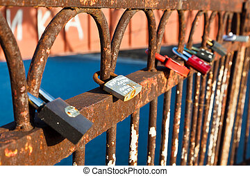 Row of Love Locks on the Rusty Bridge across Volga River...