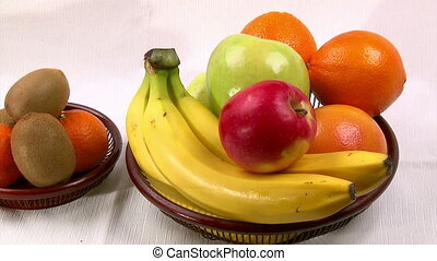 Fruits arranged on a white table, camera dolly