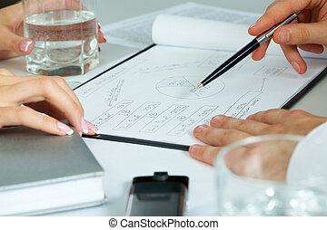 Consultation - Close-up of human hands working with...