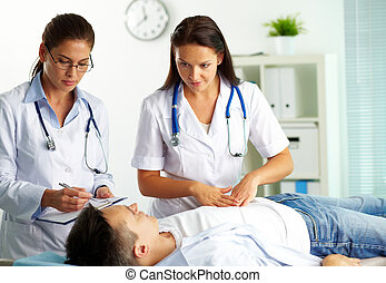 Medical treatment - Portrait of confident female doctors...