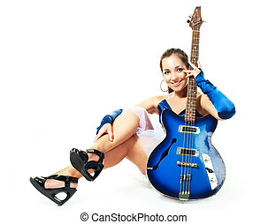 woman with a guitar - portrait of a sexy young brunette...