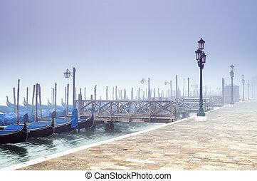 Gondolas in the morning fog in Venice