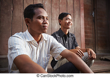 Two young Asian men smiling - Two male cambodian friends...