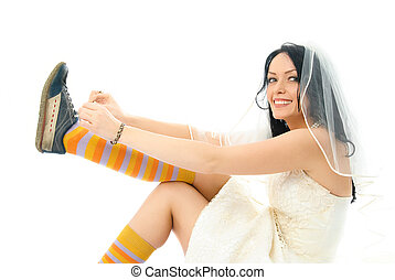 happy bride putting on sporting shoes - beautiful happy...