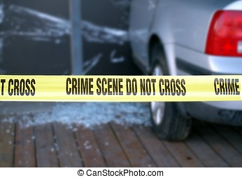 Yellow Tape Blocks a Crime Scene - Yellow tape is put up to...