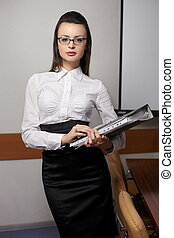 beautiful business woman  in glasses with red lips and documents in the office