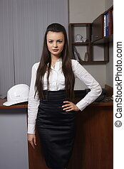 Portrait of a cute young business woman in an office environment