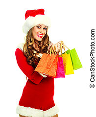 girl dressed as Santa with bags - portrait of a sexy young...