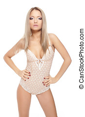 Young and sexy blond woman in white corset lingerie bright...