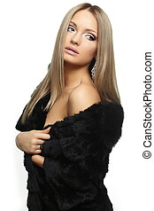 beautiful sexy nude american blond lady girl in a warm black expensive fur coat bright makeup big lips isolated on white