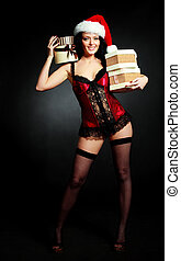 sexy woman with presents - sexy young brunette woman wearing...