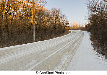 Windy Winter Road - A Snow Covered Road Winding Through the...