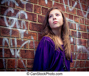 Girl on Grungy Wall