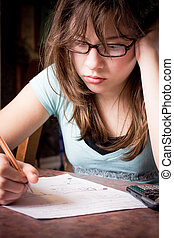 Student Struggling - Teenage girl struggling with school...