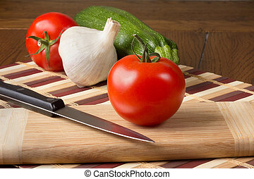 Vegetables on Cutting Board - Tomatoes, zucchini and garlic...