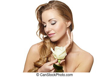 Portrait of sensual smiling beautiful woman with white rose...