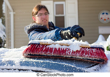 Snow Removal - Removing snow from a car with a broom