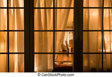 Night Window - View through french pane window at night into...