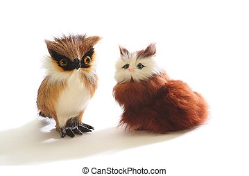 Pair of cute fluffy toys: kitten and owl, isolated on white...