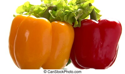 Three peppers, green lettuce, rotate, closeup.