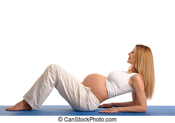 pregnant woman lying down and practicing yoga on isolated...