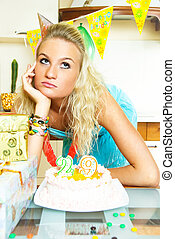 depressed girl celebrating birthday - portrait of a...