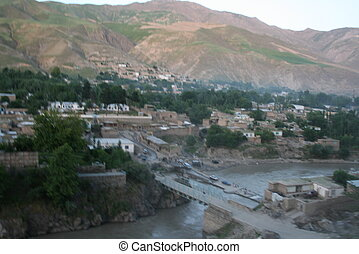 Faizabad, Afghanistan - Faizabad town with a mountain in the...