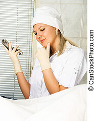 thoughtful gynecologist - portrait of a young thoughtful...
